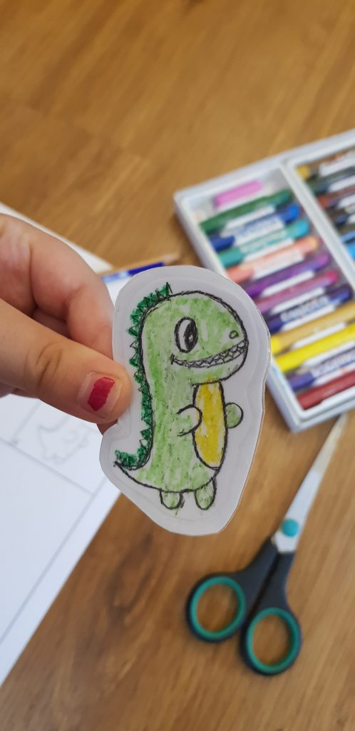 how to make a sticker DIY using your drawing , with a transparent sticker paper , drawing paper , pencil , crayons and scissors.